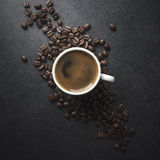 Cup of coffee and beans on table Royalty Free Stock Photography