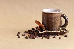 Cup and coffee beans on table royalty free stock photos