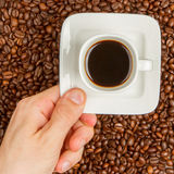 Cup of coffee on beans. top view Royalty Free Stock Photo