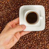 Cup of coffee on beans. top view Stock Photo