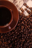 Cup of coffee on beans, view from above Stock Photography