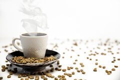 Cup of coffee and beans. Cup of coffee and coffee beans  on white Royalty Free Stock Photography