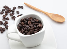 Cup of coffee beans on white background Royalty Free Stock Photos