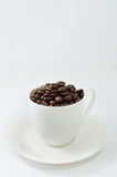Cup of coffee beans. Cup of coffee, on white background Royalty Free Stock Images