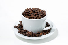 Cup with coffee beans on white background, closeup. Horizontal Royalty Free Stock Photography