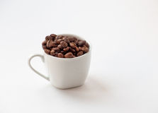 Cup of coffee beans. Royalty Free Stock Image