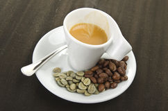 Cup of coffee and beans Stock Image