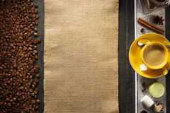 Cup of coffee and beans on wood Stock Image
