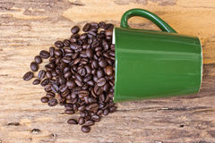 Cup of coffee beans is on wooden board Stock Photo