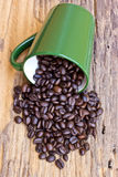 Cup of coffee beans is on wooden board Royalty Free Stock Image
