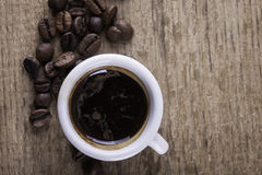 Cup, coffee beans on wooden Board closeup top view background stock photos