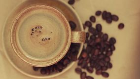 Cup of coffee with coffee beans. 1920x1080 stock video footage