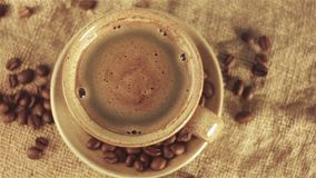 Cup of coffee with coffee beans. 1920x1080 stock video