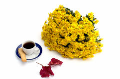 Cup of coffee, beautiful autumn leaf and bouquet of flowers Stock Images