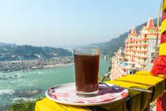 A Cup of coffee on a beautiful background of the city Rishikesh. Tourist Indian Breakfast at early morning in the Himalayan mountains royalty free stock images