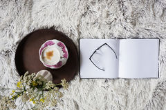 Cup of coffee in bed Royalty Free Stock Photography