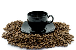 Cup and coffee beens Royalty Free Stock Images