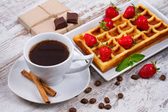 Cup of coffee, Belgium waffle and strawberries. Stock Image