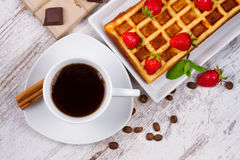 Cup of coffee, Belgium waffle and strawberries. Royalty Free Stock Images