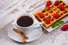 Cup of coffee, Belgium waffle and strawberries. Stock Photography