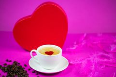 Cup of coffee with big red heart in the background. Style, valentins day Royalty Free Stock Photography