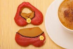 Cup coffee bikini underwear gingerbread cake cookie on bamboo mat Stock Image