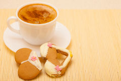 Cup coffee bikini underwear gingerbread cake cookie on bamboo mat Stock Photo