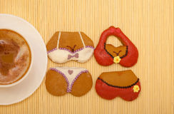 Cup coffee bikini underwear gingerbread cakes cookies bamboo mat Stock Photo