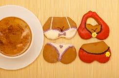 Cup coffee bikini underwear gingerbread cakes cookies bamboo mat Royalty Free Stock Photos