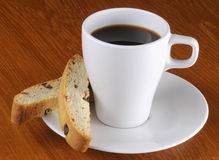 Cup of coffee and biscotti Stock Photos