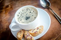 A cup of coffee with biscotti Royalty Free Stock Photography