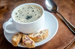 A cup of coffee with biscotti Royalty Free Stock Image
