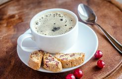 A cup of coffee with biscotti Royalty Free Stock Photos