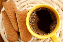 cup of coffee and a biscuit for breakfast Royalty Free Stock Images