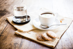 Cup of coffee and biscuit Stock Image