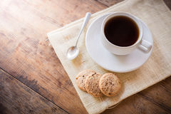 Cup of coffee and biscuit Stock Photos