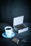 Cup of coffee, biscuits and a box of cigarettes Royalty Free Stock Photos