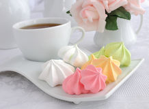 A cup of coffee and biscuits meringue on a plate Stock Photography