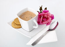 A cup of coffee with biscuits and a rose. A delicious cup of coffee with biscuits and a rose, arranged next to it for a perfect morning Royalty Free Stock Photography