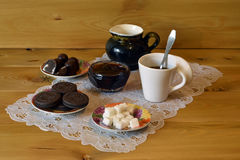 A cup of coffee and biscuits Stock Image