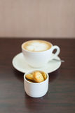 Cup of coffee and biscuits on wooden board Royalty Free Stock Photo