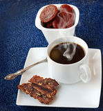 A cup of coffee with a bit of sugar homemade apple fruit candy Royalty Free Stock Image