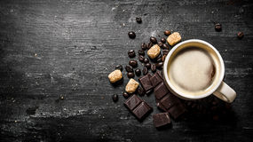 Cup of coffee with bitter chocolate and dark brown sugar. Stock Photos