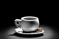 A cup of coffee on a black Royalty Free Stock Photography