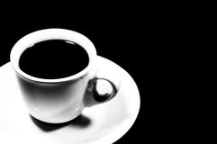 Cup of coffee on black background Stock Images