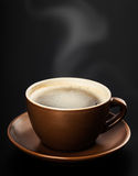 Cup of coffee on black background Royalty Free Stock Photo