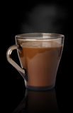 Cup of coffee on a black background. Drink  glass  cup  closeup  food  cafe  coffee  beverage  black  hot  caffeine  aroma  brown delicious  breakfast  dark Royalty Free Stock Images