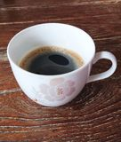 A cup of coffee. A cup of black coffee on wood table Royalty Free Stock Photos