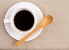 A cup of coffee. A cup of black coffee with wooden spoon Royalty Free Stock Images