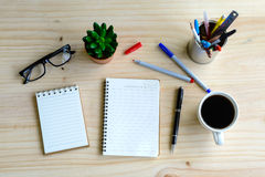 Cup of coffee with blank notebook on desk Royalty Free Stock Images